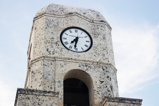 Clock tower Worth Avenue in West Palm Beach, Florida close-up with sky background