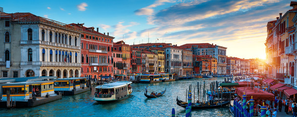 Wall Mural - Panorama of Venice at sunset, Italy. Scenic view of Grand Canal in twilight. It is a top tourist attraction of Venice. Beautiful cityscape of Venice at dusk. Romantic water trip in Venice in evening.