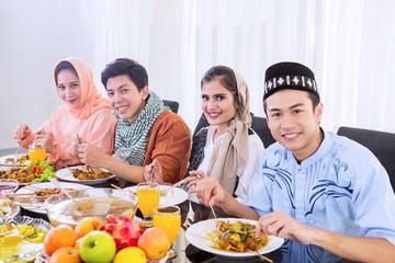 Muslim people enjoying meals at breaks the fast