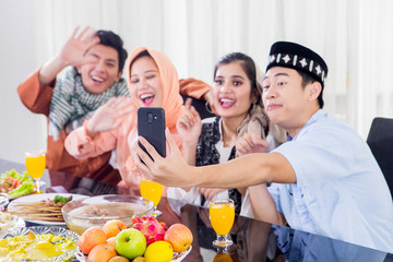 Muslim people make a video call with a phone