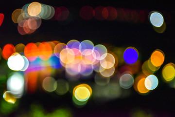 Lighting halo background with blurred urban night scenes