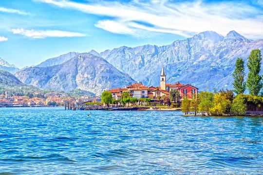 Isola Dei Pescatori Island on the beautiful Lake Lago Maggiore in the background of the Alps mountains, Stresa, Italy