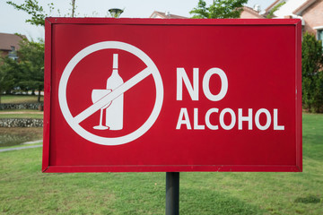 Close-up of the no alcohol sign in the park near residential area.