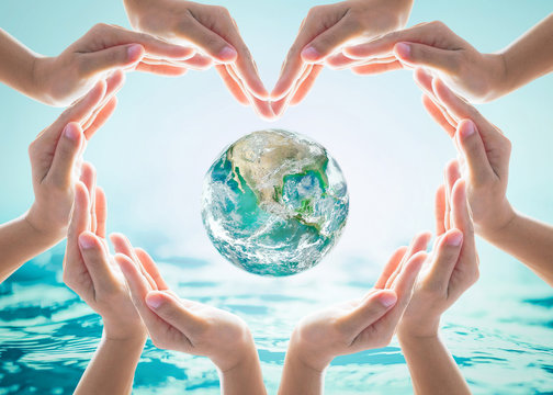 World water day and environmental protection concept with heart hands love earth in community volunteer's hands. Element of this image furnished by NASA
