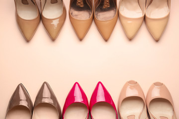 Different stylish high heeled shoes on color background Fototapete