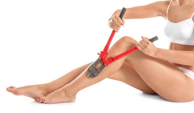 Beautiful young woman with nipping pliers on white background. Depilation concept