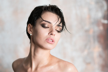 portrait of a young beautiful girl with wet hair