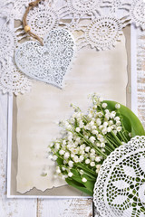 Poster de jardin Muguet de mai vintage style flat lay with bunch of lily of the valley flowers