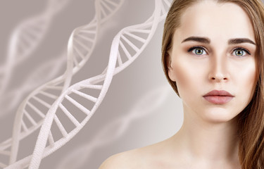 Portrait of sensual woman among DNA chains.