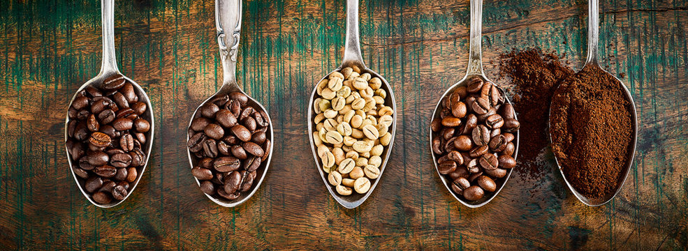 Assortment of different coffee in vintage spoons