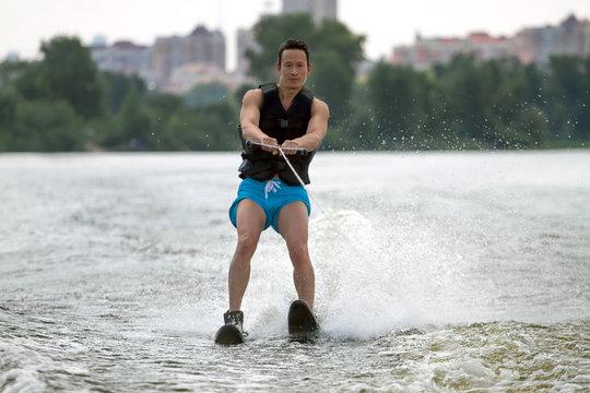 Man riding water skis