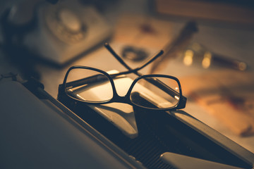 glasses on typewriter