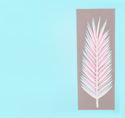 Wall Mural - Tropical palm leaves on pastel blue background, top view, flat lay. Creative botanical layout. Copy space