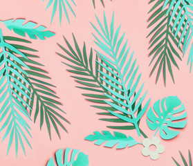 Wall Mural - Turquoise green tropical leaves  on pastel pink background, top view, flat lay. Creative botanical layout