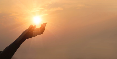 Fototapete - Woman hands praying for blessing from god on sunset background