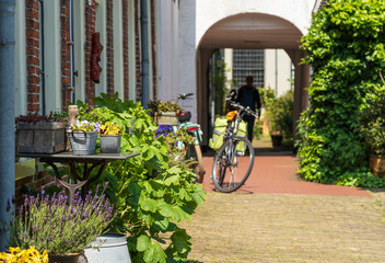 Detail of old public courtyard 'Pepergasthuis' in the Dutch city of Groningen on a spring day.