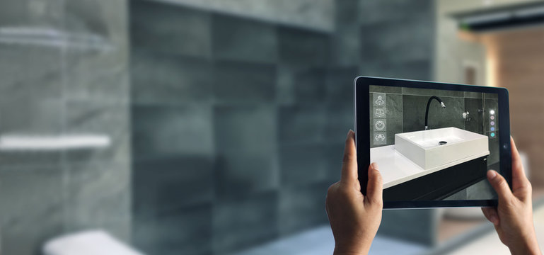 Augmented Reality bathroom planning. Sanitary ware. Hand holding digital tablet in real home background, AR application. A new way to experience products.