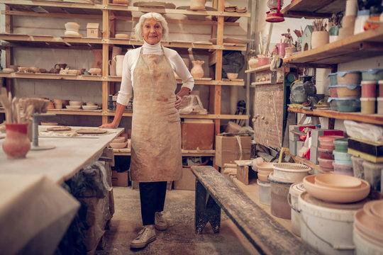 Nice senior woman working in her workshop