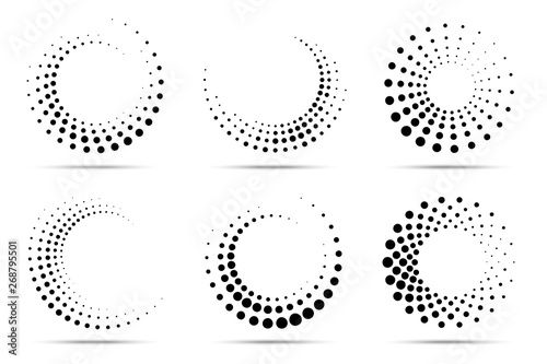 Wall mural Halftone circular dotted frames set. Circle dots isolated on the white background. Logo design element for medical, treatment, cosmetic. Round border using halftone circle dots texture. Vector