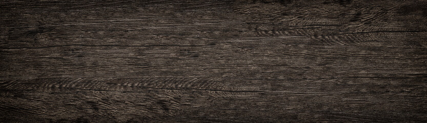 Wooden solid surface wide texture. Dark brown wood panoramic background