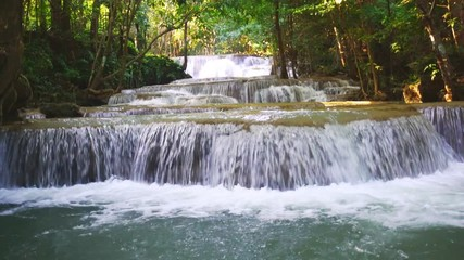 Wall Mural - Waterfall flow standing with forest enviroment low angle view in thailand called Huay or Huai mae khamin in Kanchanaburi Provience, Thailand., Zoom out.
