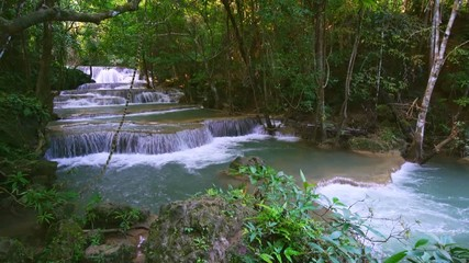 Wall Mural - Waterfall flow standing with forest enviroment high angle view in thailand called Huay or Huai mae khamin in Kanchanaburi Provience, Thailand., Tilt down.