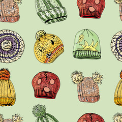 Seamless pattern with hand drawn knitted hats and berets. Colored elements on green background.