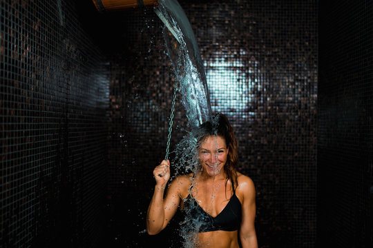 Beautiful Woman Under the Ice Cold Shower Bucket