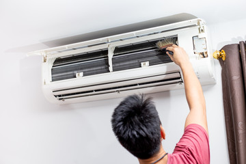 man brush  air conditioner fin coil dust  cleaning at home