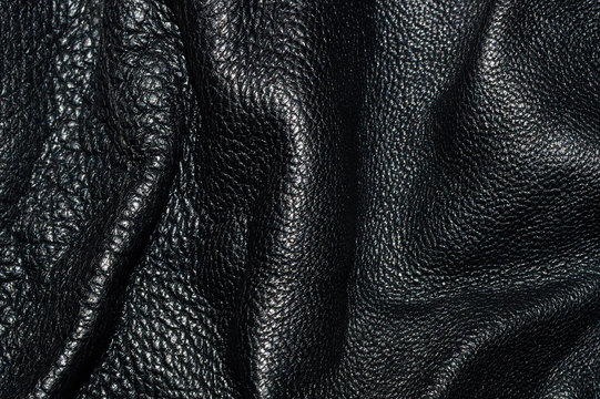 Texture of black leather rumpled