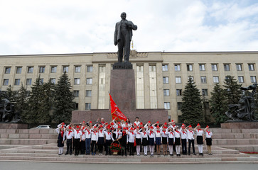 Children wearing red neckerchiefs pose for a picture after an inauguration ceremony of newly-joined members of the Young Pioneer Organisation in Stavropol