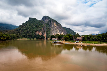 house on lake, digital photo picture as a background. Mekong river Bank in Laos. Beautiful scenery.