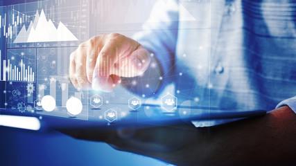 Businessman analysis business graph on virtual screen interface. business concept,technology,management