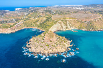 Gnejna and Ghajn Tuffieha bay on Malta island. Aerial view from the height of the coastlinescenic sliffs near the mediterranean turquoise water sea.