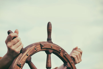 Steering hand wheel ship on sky background