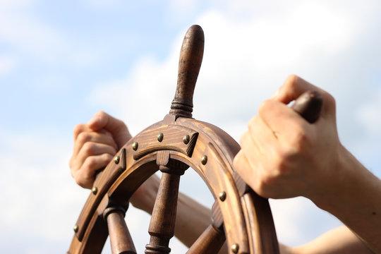 Steering hand wheel ship on sky background