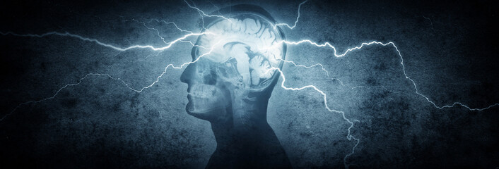 Silhouette of a man's head with x-rayed head and lightning coming out of the brain. Conceptual idea and symbol of the work of the brain, thinking, power of mind.