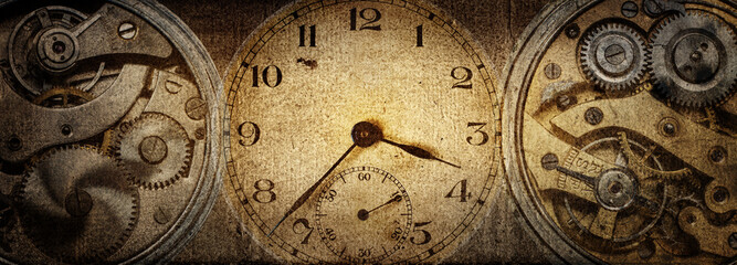 The dials of the old antique classic clocks on a vintage paper background. Concept of time,...