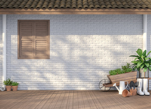 House terrace with garden equipment 3d render,There are empty white  brick wall, wood floor and brown roof,Sunlight shining to the wall with tree shadow.