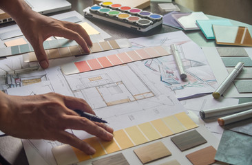 Architect designer Interior creative working hand drawing sketch plan blue print selection material color samples art tools Design Studio Fototapete