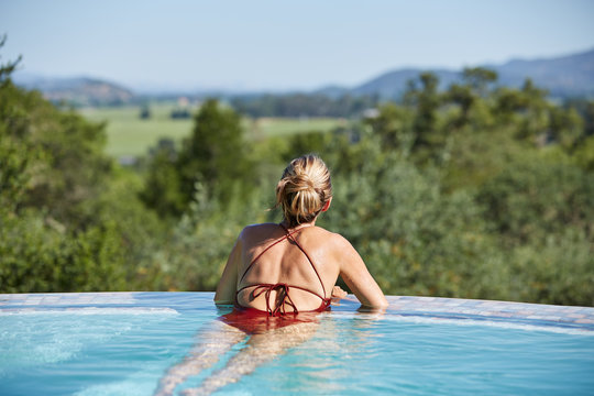 Mature woman relaxing looking at view in spa swimming pool