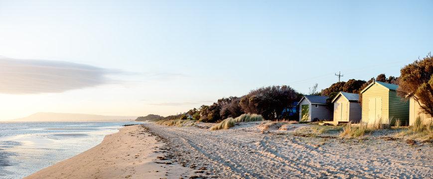 Wide angle panorama of coastal beach huts in Australia