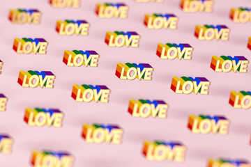 Closeup shot on Golden LOVE word with rainbow outline pattern. June as a month of gay pride and love concept. Isolated on pink background. 3D rendering