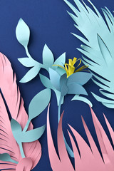 Handcraft flowers paper origami from colored paper on a blue wit