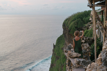 Woman Taking Selfie On A Edge Of Cliff Mountain