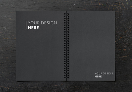 Open Notebook Mockup on a Black Table
