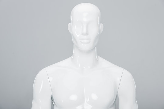 white plastic mannequin doll isolated on grey