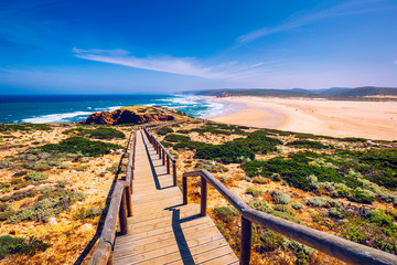 Praia da Bordeira and boardwalks forming part of the trail of tides or Pontal da Carrapateira walk...