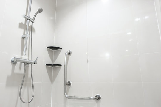Toilet shower and handrail for elderly people at the bathroom in hospital, safty and medical concept