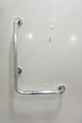 Toilet and handrail for elderly people at the bathroom in hospital, safty and medical concept